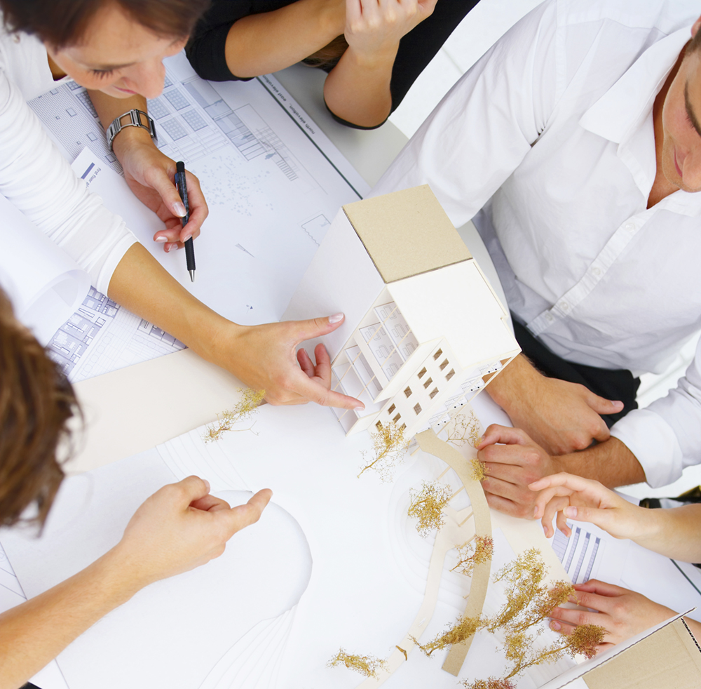 A group of architects discussing the plans for a new building